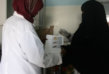Laboratory workers testing the quality of medicine samples collected from a number of pharmacies
