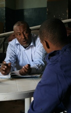 A psychiatrist talks with a patient at the Hargeisa mental health ward