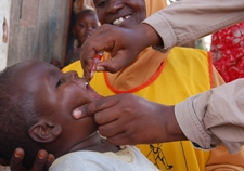 A child is administered two drops of polio vaccine during the immunization campaigns in Somalia