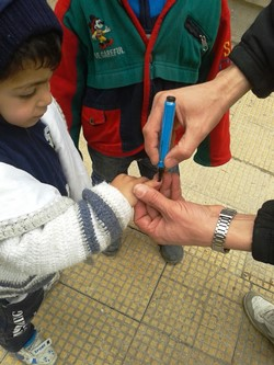 A_young_boy_has_his_finger_marked_after__polio_vaccination