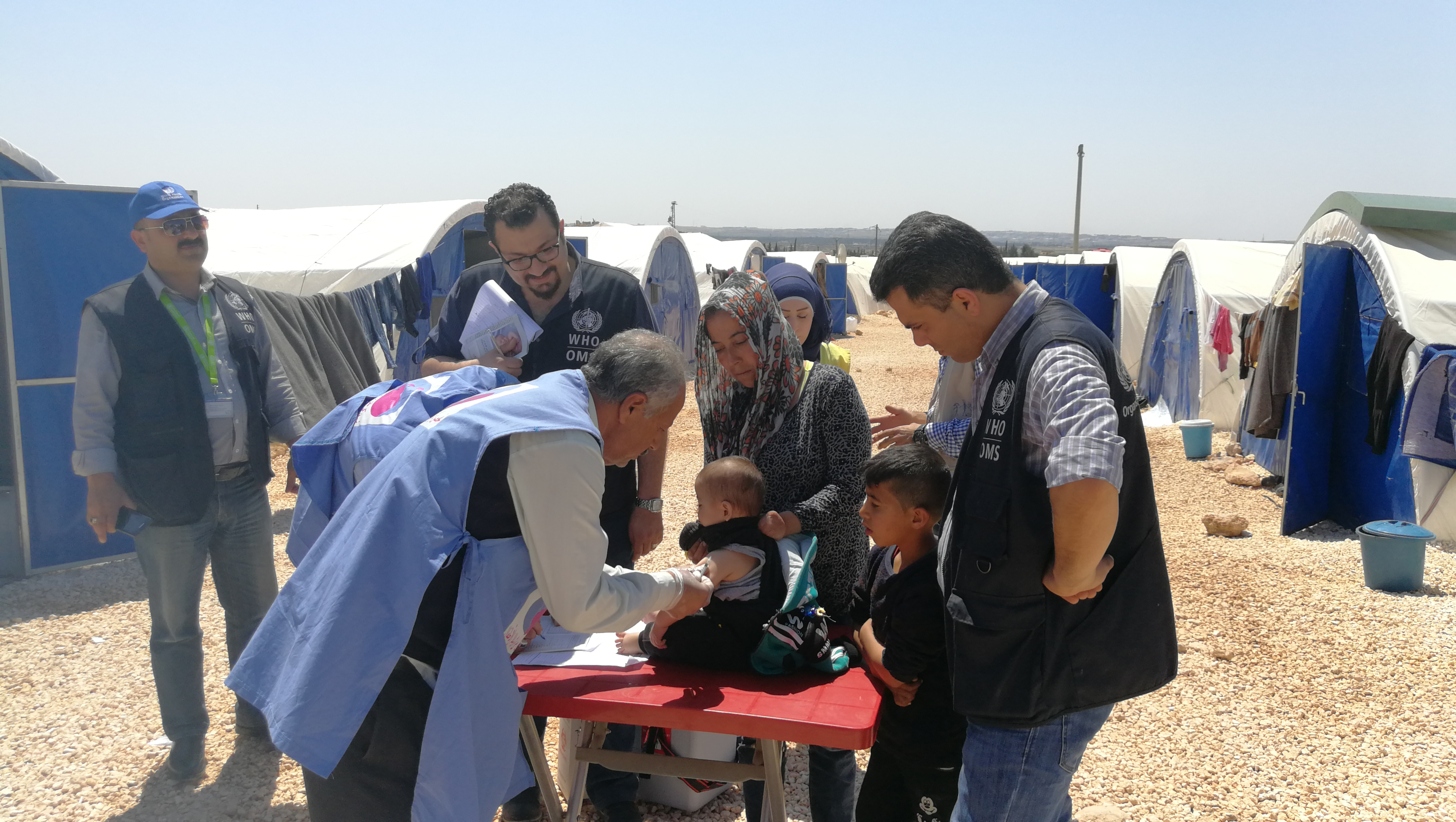 WHO-supported_vaccination_team_is_providing_immunization_services_to_children_in_Fafin_IDP_camp_in_rural_Aleppo._PhotoWHO.Syria_2019