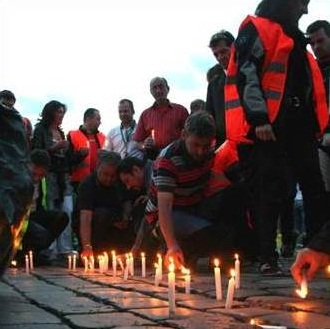 People lighting candles in remembrance of World Day of Remembrance for Road Traffic Victims