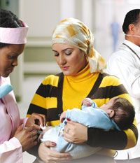 A child is receiving vaccination while being held by his mother
