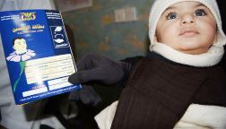 7-month-old Obad Moshtaq is waiting with his mother to receive IPV vaccination