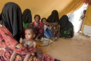 A displaced family in their tent at Mazraq refugee camp, Yemen