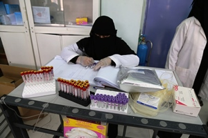 Health worker records blood samples collected from the national blood transfusion and research centre in Sana'a