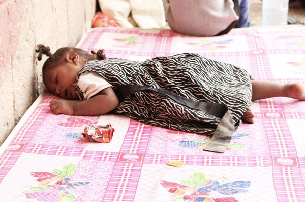 Nada's daughter is sick and lays on this mattress which she shares with her 3 brothers and sisters and mother. They have to sleep in the school corridor until they get a classroom