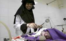 Community midwife taking care of a baby after delivery in a public health facility in Yemen